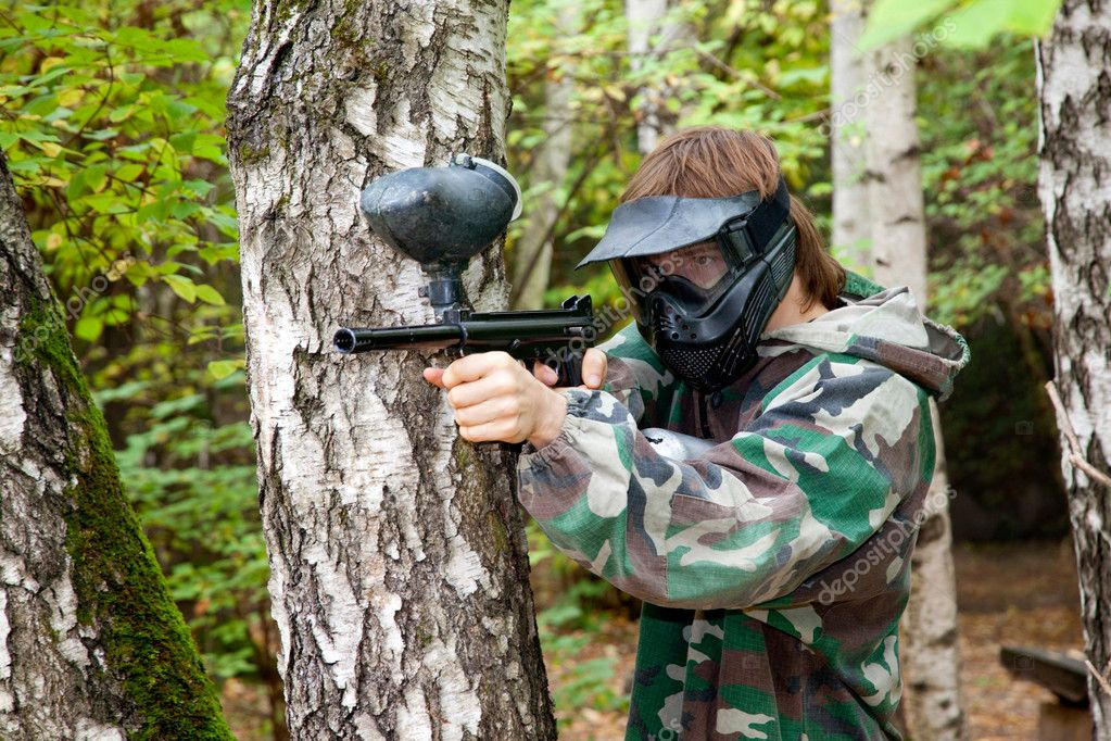 Paintball player in the forest — Stock Photo #7430179