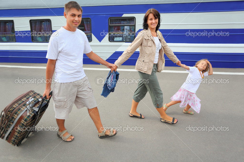 Happy family with little girl going on railway station — Stock Photo #7431078