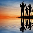 Family silhouette on sunset sky. water - Stock Photo