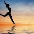 Silhouette jump girl on water — Stock Photo
