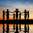 Silhouette children. sunset pond. — Stock Photo