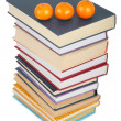 Stack of books with three mandarins — Stock Photo
