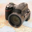 Camera on map of europe — Stock Photo