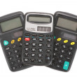 Three old vintage calculators - Stock Photo