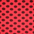 Red with black spots textile texture - Foto Stock