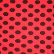 Red with black spots textile texture — Stock Photo #7440533