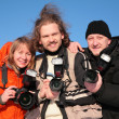 Stock Photo: Three fotographers against blue sky 2