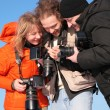 Stock Photo: Three fotographers against blue sky 3