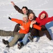 Stock Photo: Group of friends sit on plastic sled on snow 2