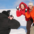 Stock Photo: Two girls throw snows into photographer