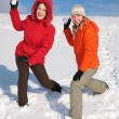 Stock Photo: Two girls throw snowballs