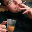 Stock Photo: Smoking man with glass