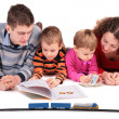 Parents look books with children - Stock Photo