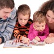 Parents with children read books - Stock Photo