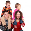 Parents with children on shoulders - Stock Photo