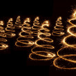 Sparkler christmas trees spiral — Stock Photo