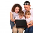 Family of four with notebook — Stock Photo
