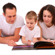 Family reads magazine — Stock Photo #7441166