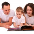 Family reads magazine — Stock Photo