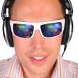 Young man with sunglasses and headphones - Stock Photo