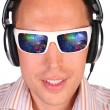 Young mwith sunglasses and headphones — Stock Photo #7441233
