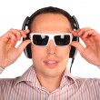 Young man with sunglasses and headphones touch glasses — Stock Photo
