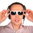 Young man with sunglasses and headphones touch glasses - Stock Photo