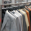 Clothes on racks in shop — Foto de stock #7441669