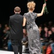 Fashion pair on podium from back — Stock Photo