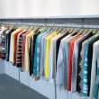 Stock Photo: Clothes on racks