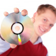 Boy in red jacket with CD — Stock Photo