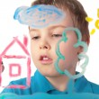 Boy paints house on glass — Stock Photo #7442491
