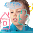 Boy paints house on glass — Stock Photo