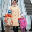Mother and children at escalator — Stock Photo