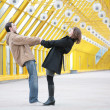 Boy and girl hold each other for  hands on  footbridge — Stockfoto