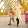 Mother with children on footbridge — Stock Photo