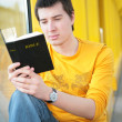 Stock Photo: Asiboy reads bible