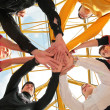 Six friends joining hands low angle view — Foto Stock