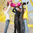 Four boys lift girl up — Stock Photo
