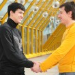 Stock Photo: Two friends handshaking on footbridge