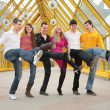 Group of young dance on footbridge — Stock Photo