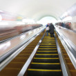 Passengers on escalator — Stock Photo