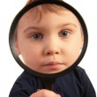 Child look through magnifier — Stock Photo #7443029