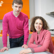 Young couple on kitchen — Stock Photo