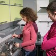 Stock Photo: Couple cooking in kitchen