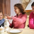 Parents with son at tea — Stock Photo