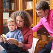 Parents read book with son — Stock Photo