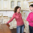 Stock Photo: Young couple stand on kitchen