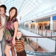 Pregnant family in universal store — Stock Photo