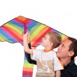 Man and boy hold kite above head — Stock Photo #7443591